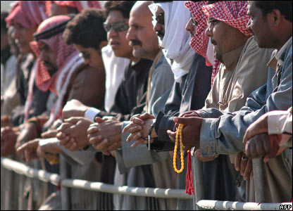 Kuwaitis wait for the funeral of their ruler, Sheikh Jaber al-Ahmad al-Sabah
