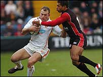 Jason Robinson tackles Richard Fussell