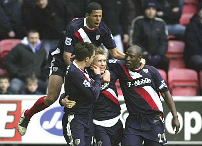 Martin Albrechtsen and team-mates celebrate as West brom take the lead
