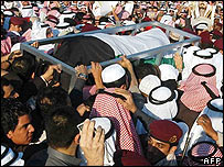 The body of Sheikh Jaber al-Ahmad al-Sabah is carried through a crowd in Kuwait