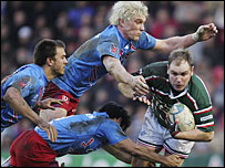 Leicester's Andy Goode is engulfed against Stade Francais