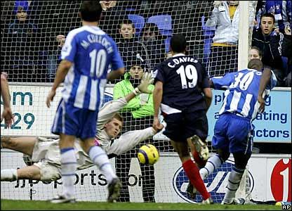 West Brom keeper Tomasz Kuszczak saves at close range from Wigan's Jason Roberts in injury time