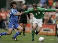 Kevin Kilbane tries to make a break down the Irish left