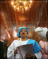 Liberian President elect Ellen Johnson-Sirleaf sings during a church service a day before her inauguration