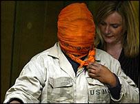 Sita Kisanga wearing orange headscarf