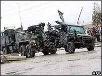 A Nato vehicle is towed away after being attacked in Kandahar, Afghanistan