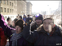 "Demonstrators march around Mongolia's parliament building as hundreds of people protest in the centre of the capital, Ulan Bator, against the MPRP""s manoeuvres and call for fresh elections, 16 January"