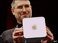 Apple's boss Steve Jobs holding a Mac Mini