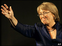 Michelle Bachelet waves to supporters after her presidential victory
