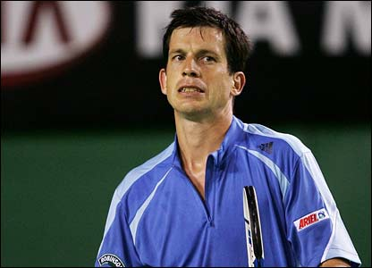 Tim Henman on his way to defeat in the first round