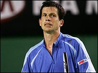 Tim Henman grimaces on his way to defeat in the first round of the Australian Open on Monday