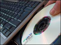 CD being placed in PC drive, BBC