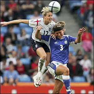 Kelly Smith beats Jessica Julin of Finland in the air