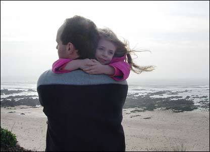 Margaret Greaves' son and granddaughter on a windy day at Freshwater West beach near Pembroke