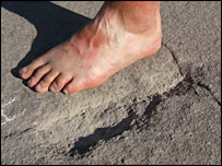 Side by side comparison of a modern human foot and a quarry marking