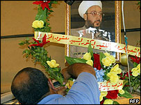 Portrait of Sheikh Khaznawi being decorated at his funeral in Qameshli