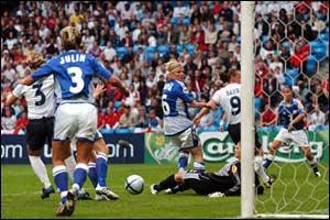 Finland's Sanna Valkonen scores an own goal