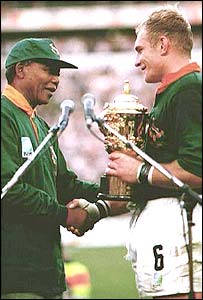 Nelson Mandela presents the Rugby World Cup to Francois Pienaar, South Africa, 1995