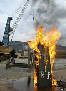 A fake coffin is burned by dockers in Pasajes, northern Spain