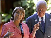 Chile's President-elect Michelle Bachelet alongside incumbent President Ricardo Lagos