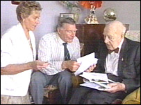 Friends help Henry Allingham open his 109th birthday cards