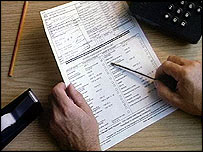 Man filling out forms