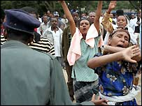 Fifty-year-old Elaynesh Negesh, center, and other Ethiopians throw their arms in despair after police barred them from entering a university where relatives were locked up as students protested recent election results on Monday, June 6, 2005. Police arrested hundreds of students who defied a government ban to protest the results of Ethiopia's disputed legislative elections, hours after surrounding and locking down the country's largest university.Police charged into crowds at Addis Ababa University to grab protesters and beat others in the first public protest against the May 15 elections. Army's special forces troops stood by, armed with assault rifles and rocket propelled grenades. Riot police with tear gas and a water cannon also stood by as regular police quelled the demonstration. (AP Photo/Boris Heger).