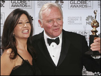 Sir Anthony Hopkins poses with his wife, Stella Arroyave, and his Golden Globe