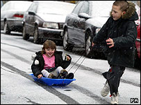 Children enjoy the snow in Barrow-in-Furness