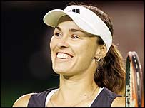 Martina Hingis smiles after defeating Vera Zvonareva