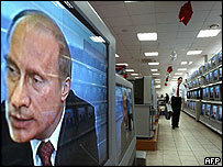 President Vladimir Putin on TV screen in Moscow shop