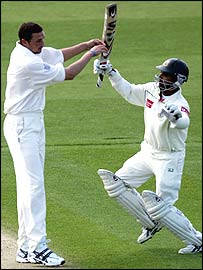 Steve Harmison and Javed Omer collide at Chester-le-Street