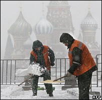 Workers clearing snow in Moscow