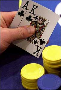 Card player with poker hand