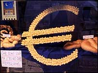 Pasta shaped in the form of the euro sign in a shop window in Bologna, 2002