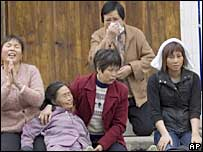 Grieving family members on streets of Dongzhou near Shanwei, Guangdong - 12/12/2005