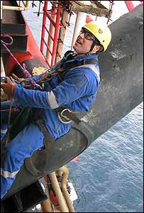 Andrew Johnson abseiling down oil platform