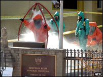 Australian Federal Police take a decontamination shower at the Indonesian embassy in Canberra, 07 June 2005,