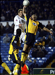 Wigan's Matt Jackson handles to give Leeds a penalty, which David Healy converts