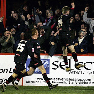 Paul Gallagher (right) celebrates in front of the Stoke fans