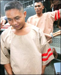 Thai fishermen Bualoi Posit, 23, foreground, and Wichai Somkhaoyai, 24 arrive at the court in Surat Thani