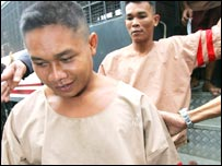 Thai fishermen Bualoi Posit, 23, foreground, and Wichai Somkhaoyai, 24, arrive at the court in Surat Thani,
