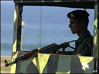 A Sri Lankan army soldier stands guard at a check point in Colombo