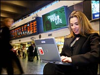 Woman using a wi-fi hotspot at a station