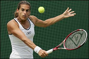 Amelie Mauresmo plays a backhand