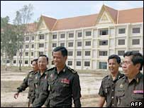 Military personnel walk past the newly-built military buildings in Cambodia - 18/1/06