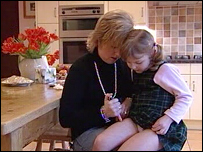 Jane Bates gives her daughter Emily an insulin injection