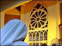 Woman praying in Nigerian church