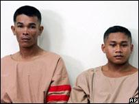 Thai fishermen Wichai Somkhaoyai, 24, left, and Bualoi Posit, 23, in court in Surat Thani