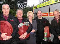 Firefighters taking hoses to Paignton Zoo